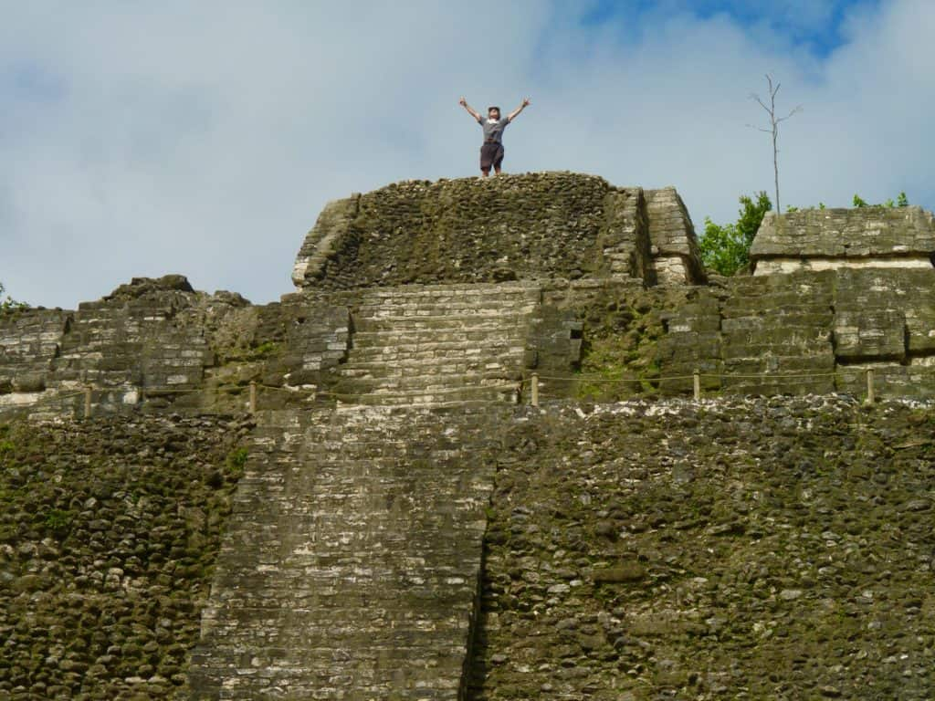 Man stands atop Lamanai Mayan ruins in northern Belize