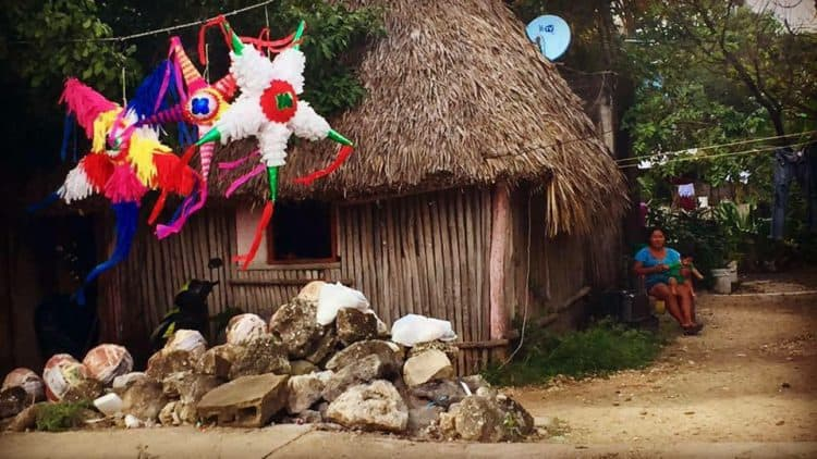 a typical home in the town of tulum where the regular people live - it's actually a hut made of sticks and straw - how Mexico changed me for the better
