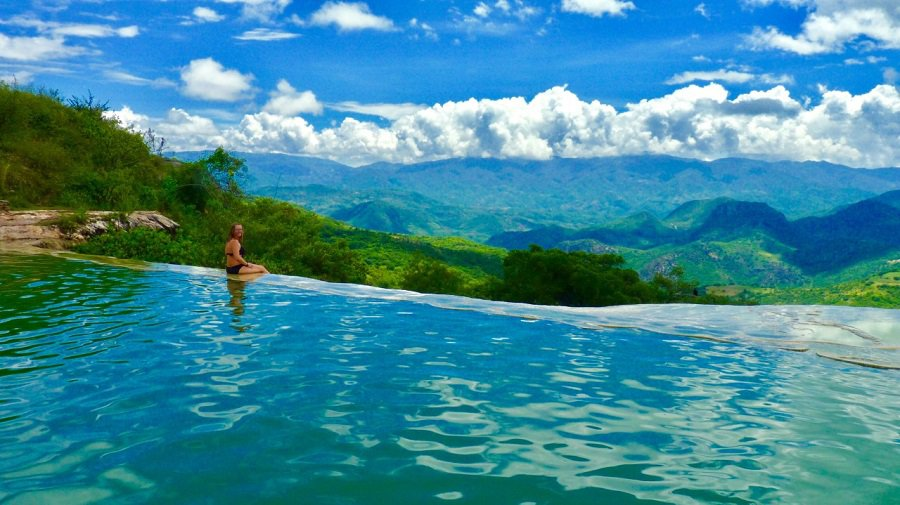 Ellen watches clouds go by from the infinity pool filled with mineral water in central Oaxaca, Mexico.
