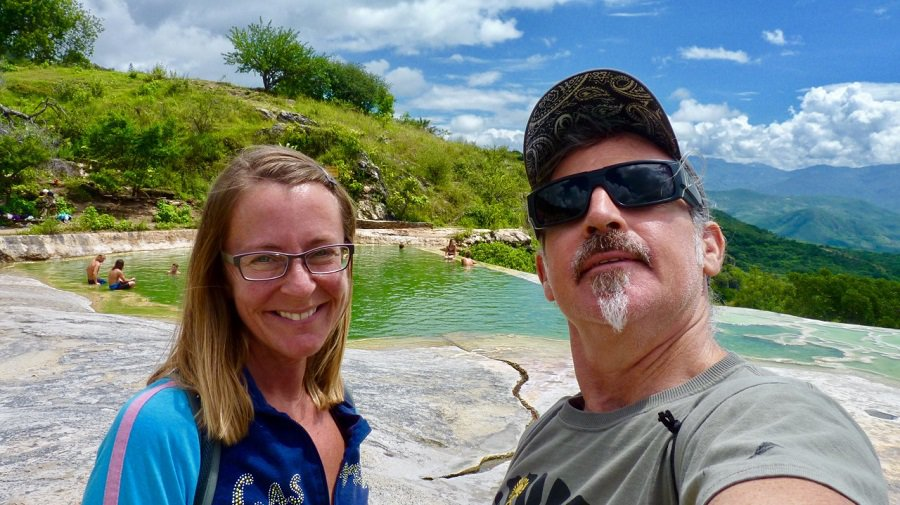 Ellen and Theo smile at an infinity pool filled with mineral springs at Hierve el Agua.