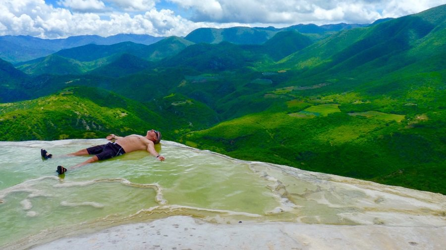 overachiever relaxes in the infinity pool at Hierve el Agua in Oaxaca