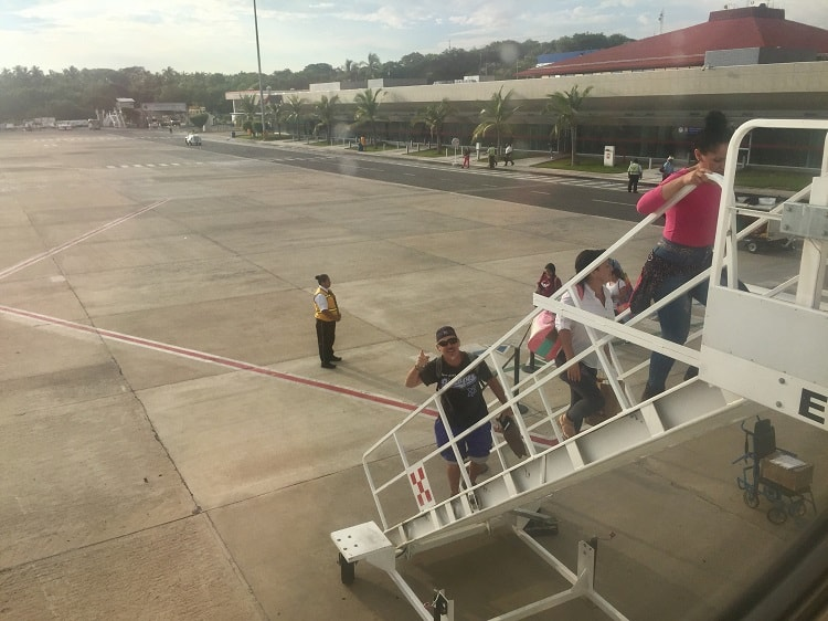 man walks up stairs to volaris flight, which is one of the mexican airlines