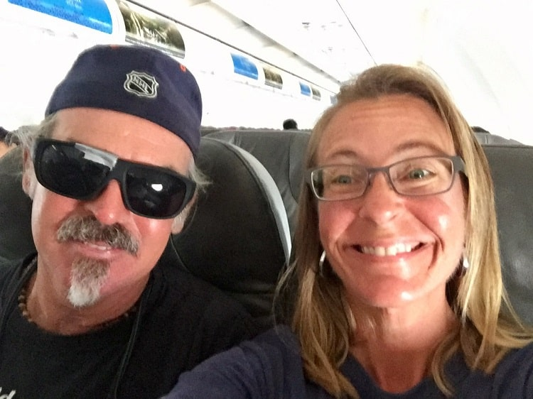 smiling couple on a plane