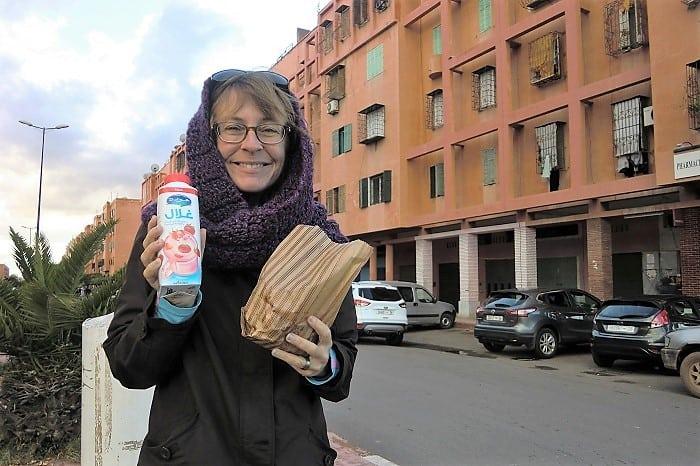 a traveler smiles in a Marrakesh neighborhood