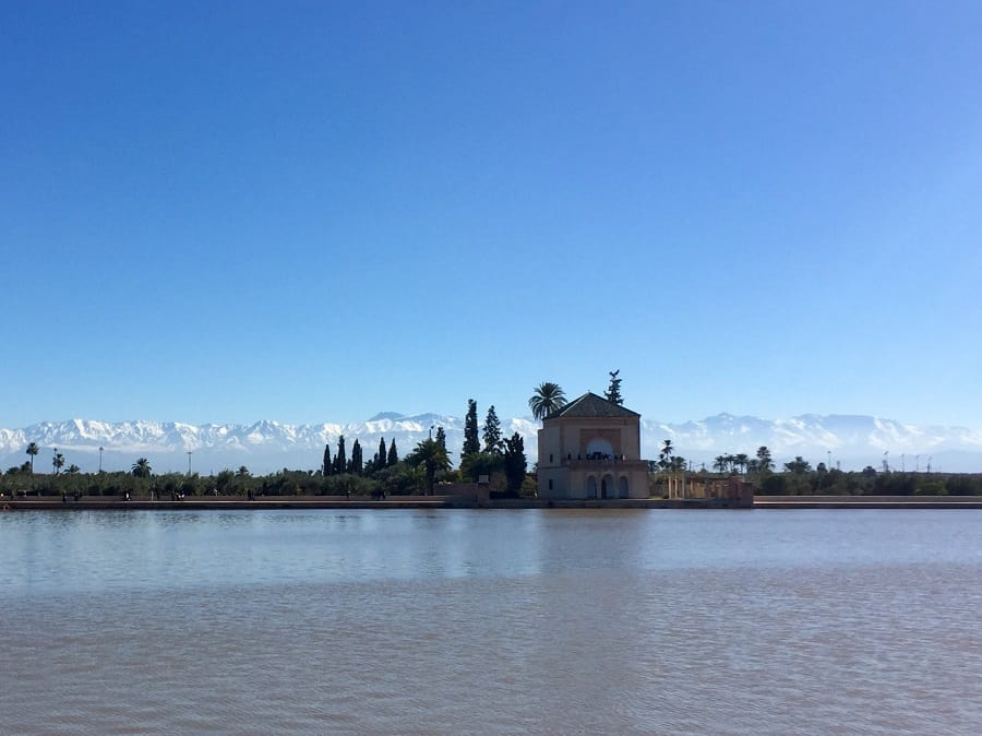 the reservoir station outside the city of marrakesh with the atlas mountains in the background