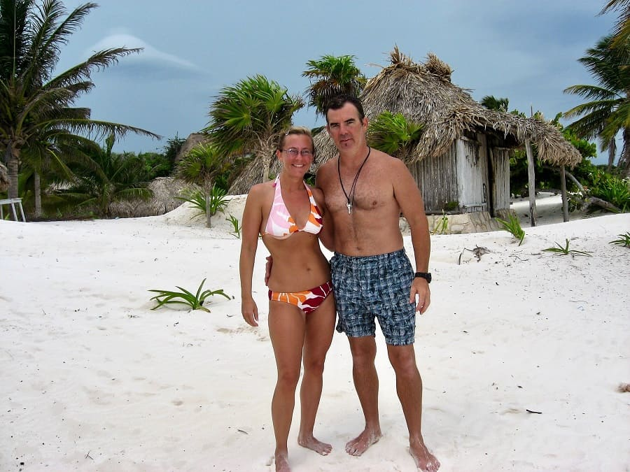Young couple on Tulum Beach in Mexico, who planned to retire early and live on beaches year-round.