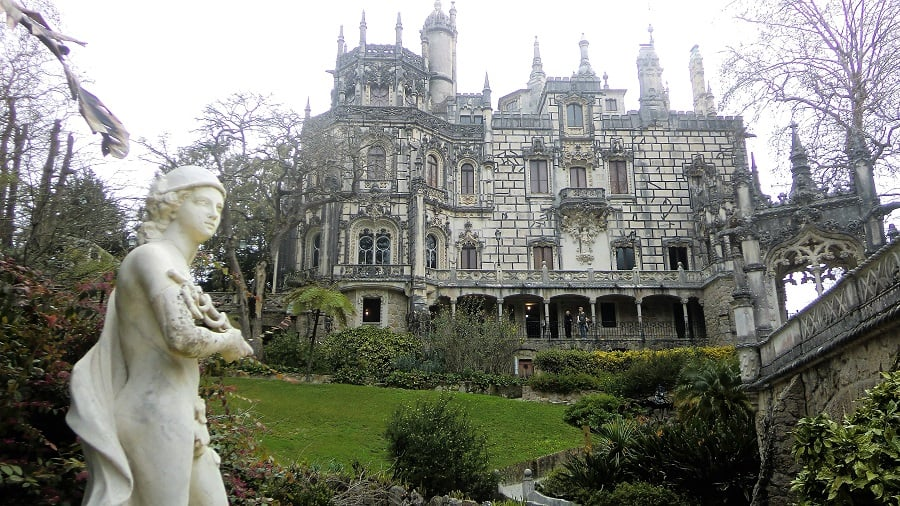 sintra palaces - regaleira is picutred - it's a massive stone structure
