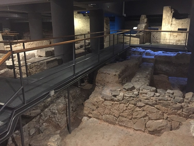 free museum days in barcelona let tourists walk over the buried sections of the city from ancient times