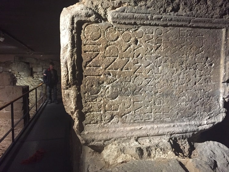 an ancient roman tablet with writing, as seen during free museum days in barcelona
