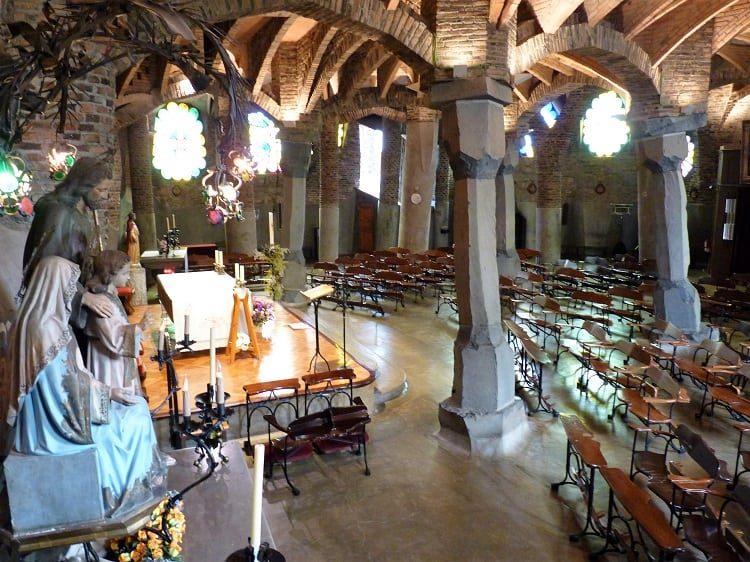 another view of the inside of a church built by antoni gaudi in Colonia Guell