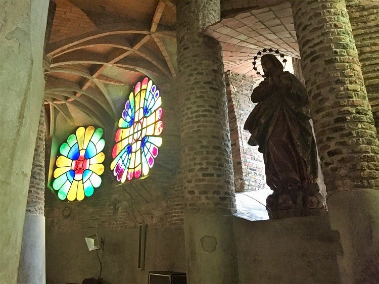 stained glass colors light in another church built by gaudi, similar to how stained glass is used in la sagrada familia