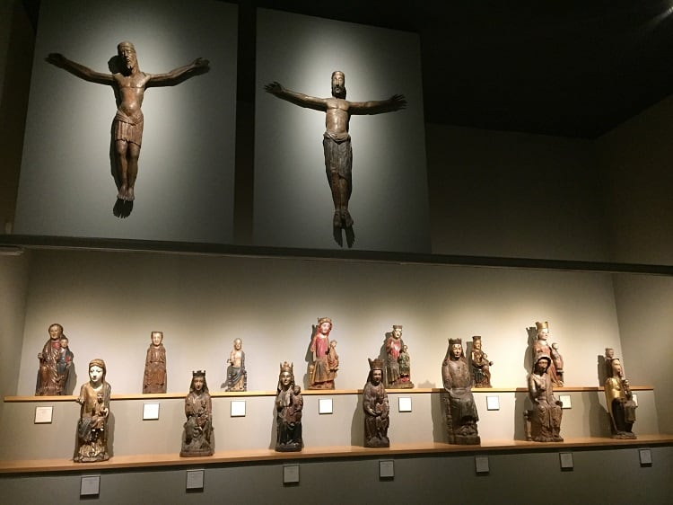 an array of crucifictions and christ statues at the frederic mares museum on free museum days in barcelona
