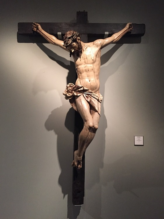 christ on a cross sculpture seen at the frederic mares museum on free museum days in barcelona