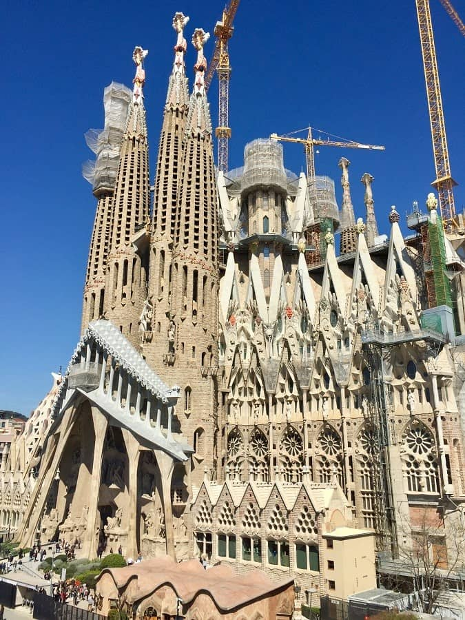an exterior shot of la sagrada familia church that shows how ornate the facade is, even though still under construction