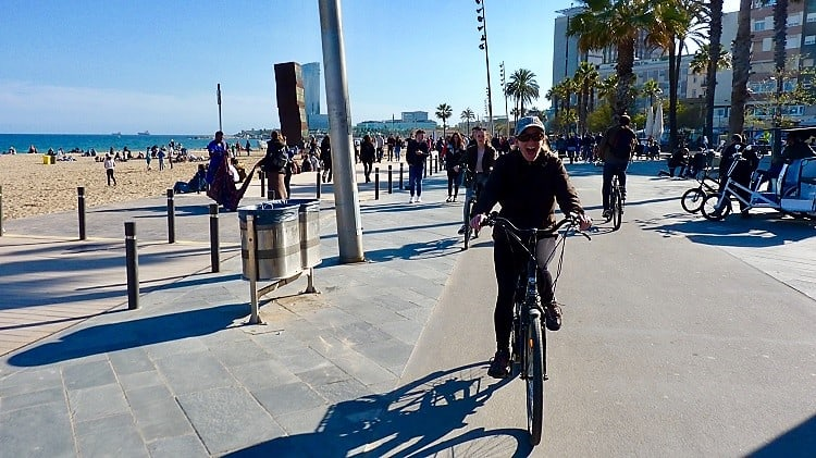 a woman rides an electric bike to illustrate activity ideas for barcelona