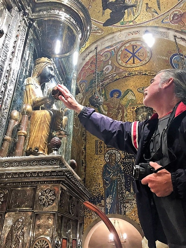 a man rubs the black orb at montserrat, and makes a wish
