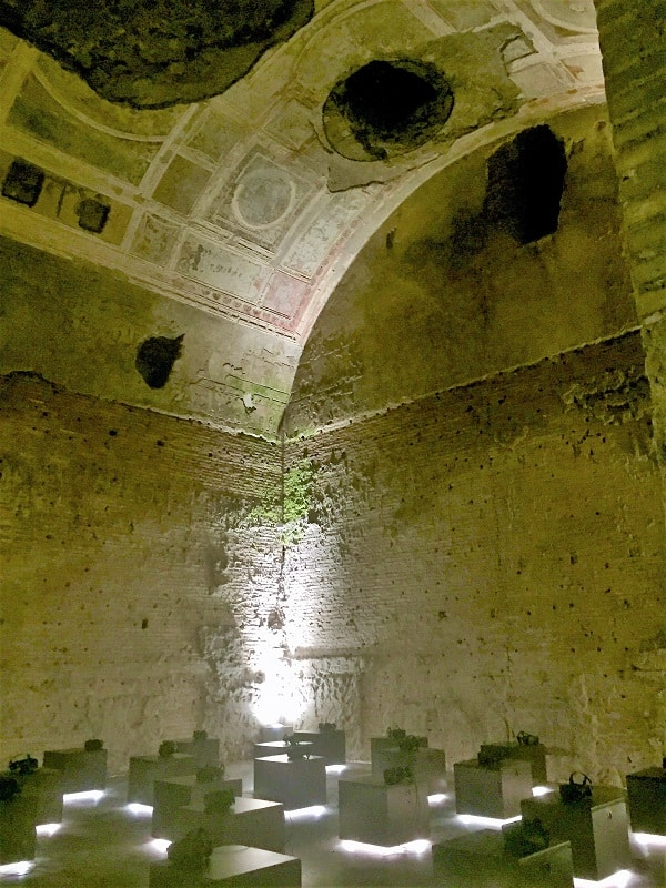 inside the virtual reality chamber at domus aurea in rome with ceiling holes visible