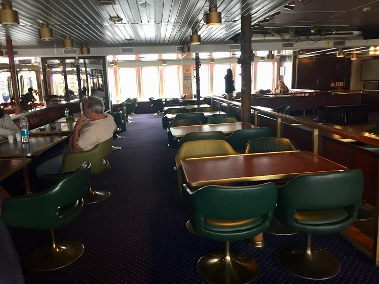 the dining area with bolted tables on the ferry from italy to croatia