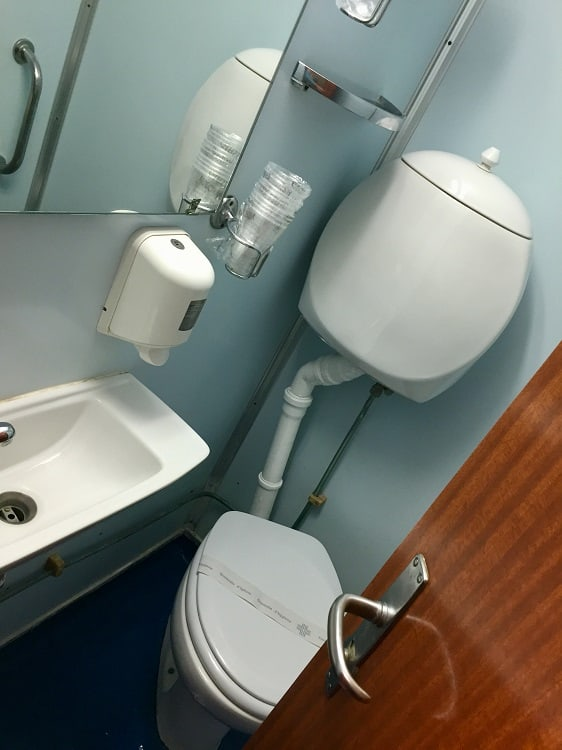 a basic bathroom with toilet and sink on the ferry from italy to croatia