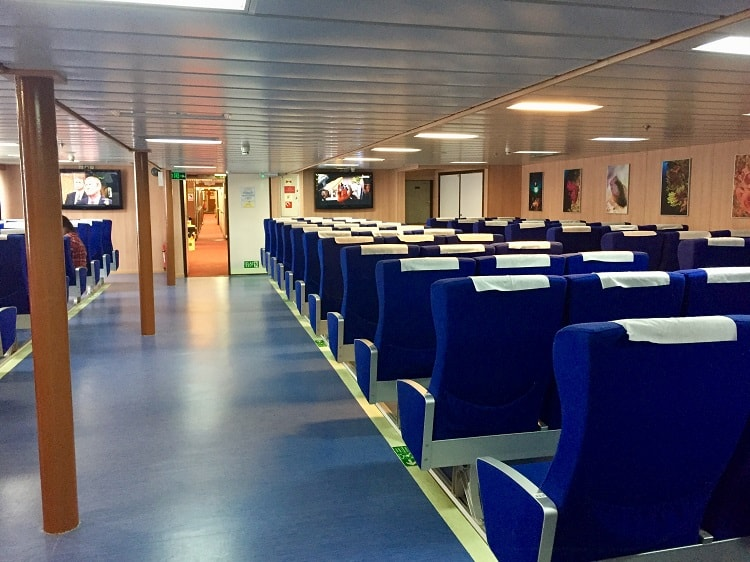 the common seating area with reclining chairs on the ferry from italy to croatia