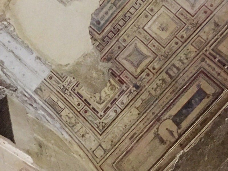 paint remains on the ceiling underground in the ancient site of domus aurea in rome