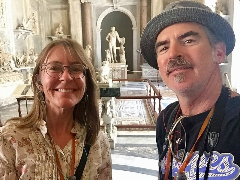 Earth Vagabonds smile in the Vatican Museums - happy to do budget travel in rome