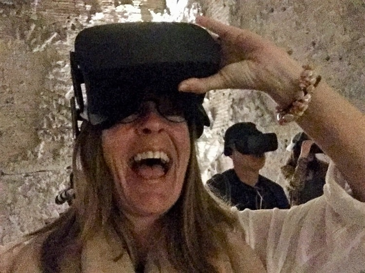 woman and man wear virtual reality headset inside domus aurea in rome