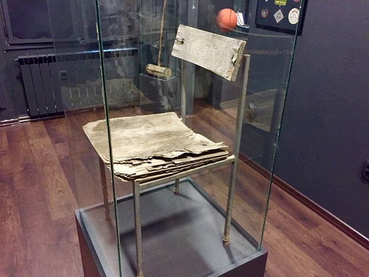 a torture chair on display at the sarajevo genocide museum
