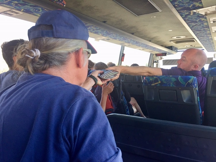 man takes passport back on the bus from montenegro to albania