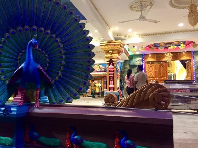 a couple prays inside a temple