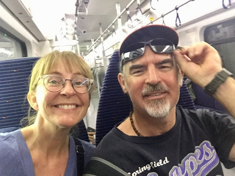 two expats in malaysia traveling by train in kuala lumpur