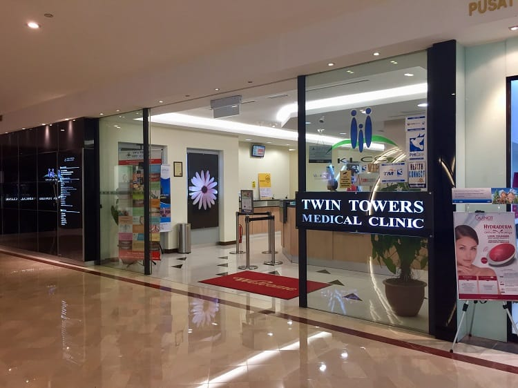 the twin towers medical clinic sign inside a mall