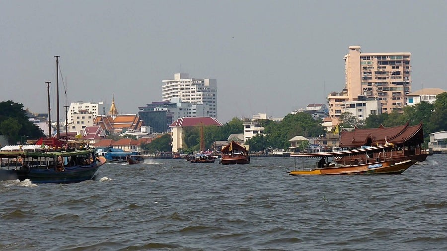 Bangkok water boats ferry people across the river