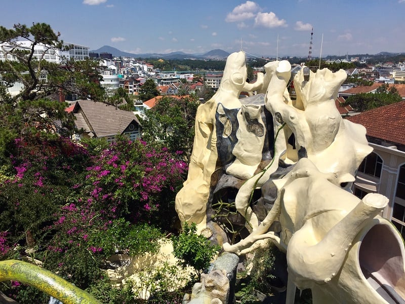 the bizarre facade of the dalat crazy house almost looks like the style of gaudi from spain