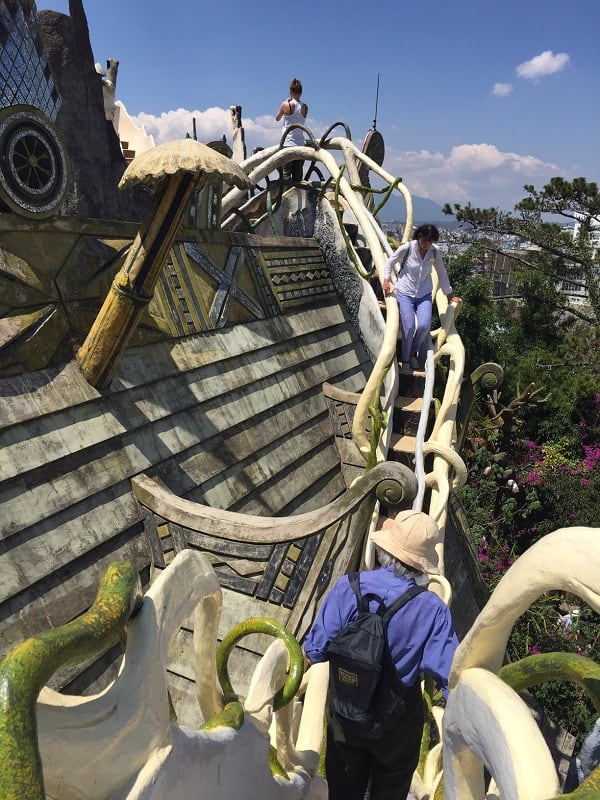 an outdoor staircase near the roof at the dalat crazy house
