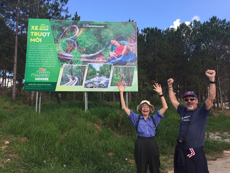 a mom and her son give their approval of the dalat roller coaster