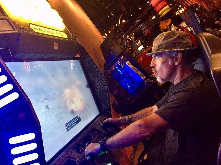 man plays video game in entertainment area of Ba Na Hills
