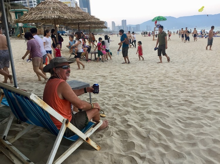 Man has beer on beach in Danang