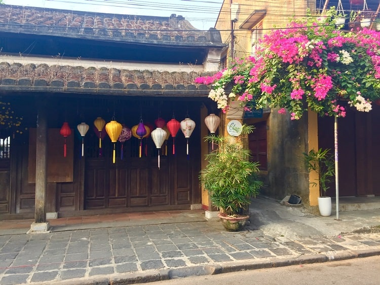 lanterns and flowers at a building in hoi an
