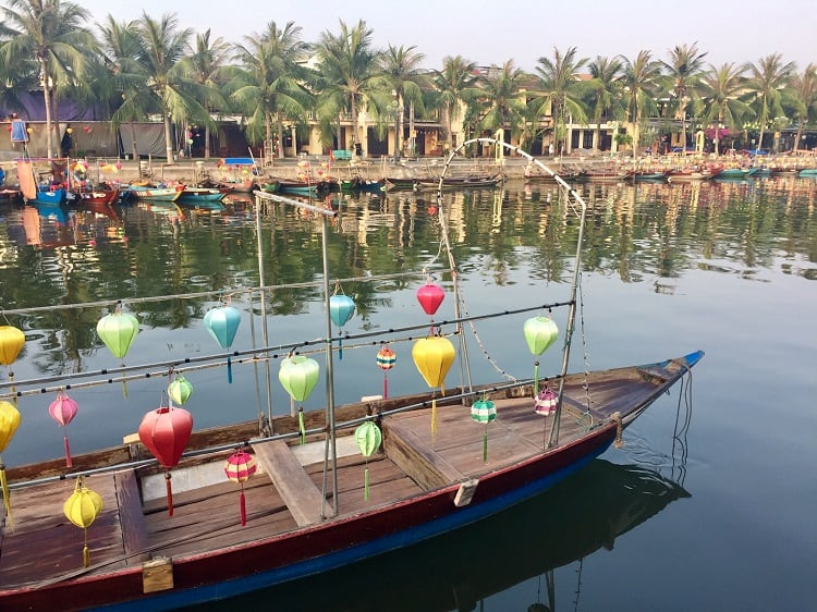 a boat with lanterns in hoi an