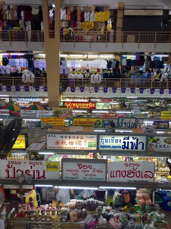 Busy interior of a city market in Chiang Mai, Thailand.