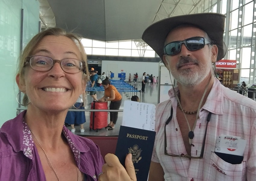 Retired budget travel through an airport with a woman holding a passport