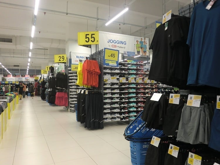 pants, shirts, shoes for sale inside a decathlon store