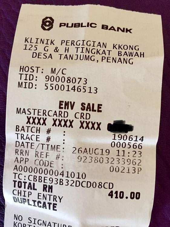 receipt for dental work shows the price in Malaysian ringgit, which is equivalent to about 97 USD