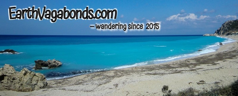 "Bright blue seawater with the words, ""earthvagabonds.com - wandering since 2015"""