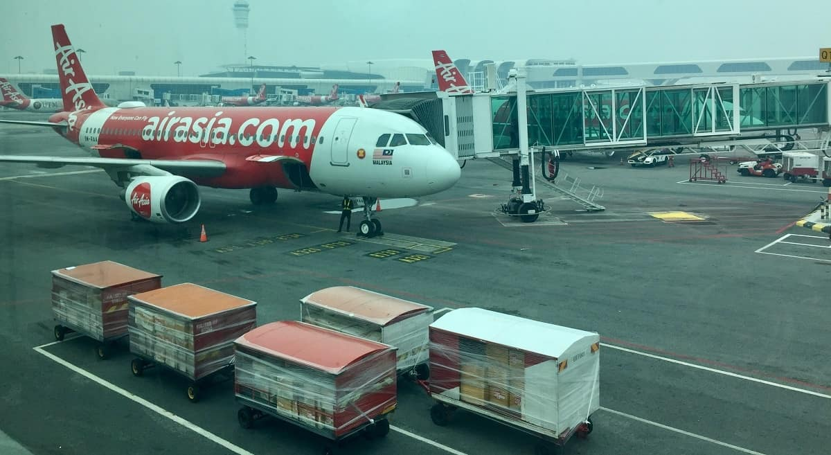 AirAsia plane on tarmac once our carry-on weight limit was tested.