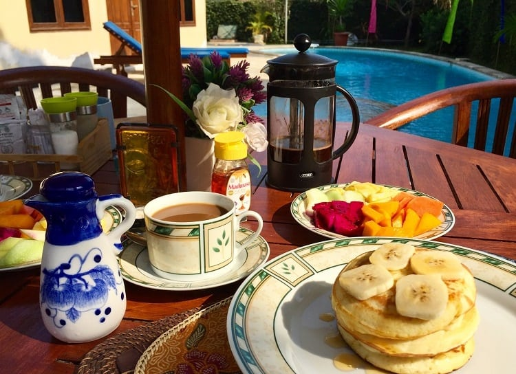 Annie made amazing breakfasts for us during our Bali vacation like this one - pancakes and fruit and coffee - for just a few dollars.