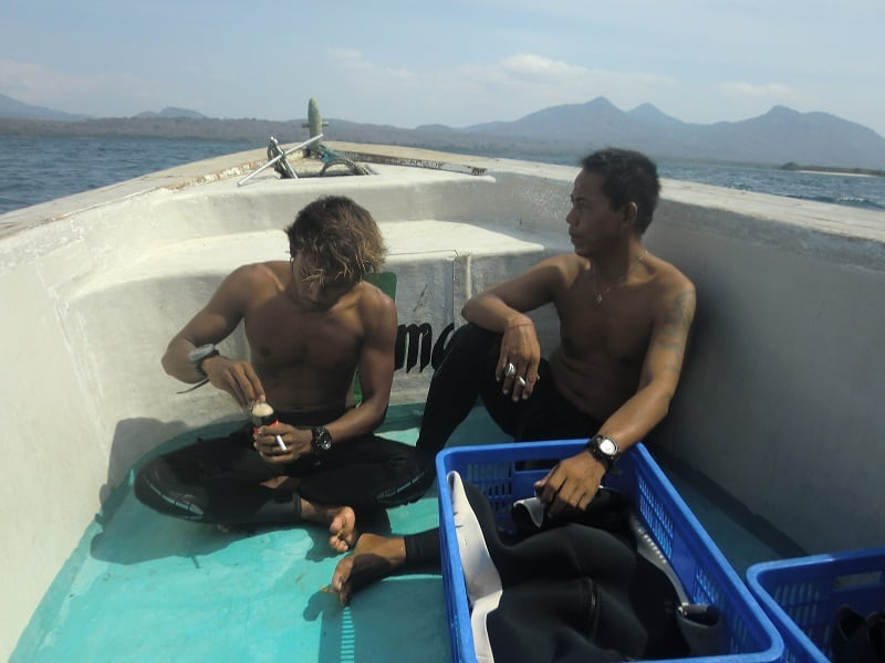 bali diving workers having lunch on the boat after a dive