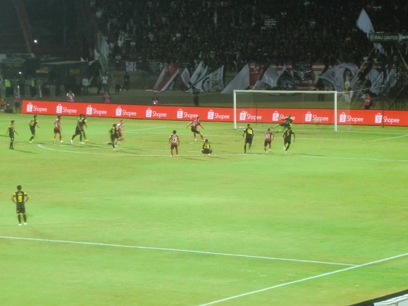 bali united team plays the borneo team on the field - not in the eat pray love version of ubud, bali