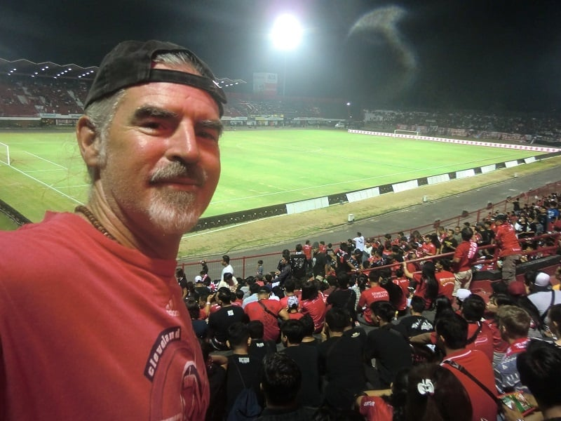 an American is at a soccer game in Ubud, Bali, with thousands of Indonesians - which definitely was not in the story eat pray love